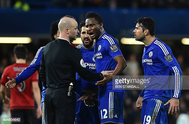 Chelsea's Brazilianborn Spanish striker Diego Costa and Chelsea's Nigerian midfielder John Obi Mikel confront referee Anthony Taylor during the...