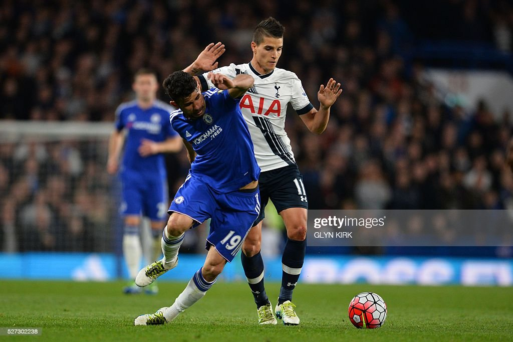 Chelsea's Brazilian-born Spanish striker Diego Costa (L) battles with Tottenham Hotspur's Argentinian midfielder Erik Lamela (R) during the English Premier League football match between Chelsea and Tottenham Hotspur at Stamford Bridge in London on May 2, 2016. / AFP / GLYN KIRK / RESTRICTED TO EDITORIAL USE. No use with unauthorized audio, video, data, fixture lists, club/league logos or 'live' services. Online in-match use limited to 75 images, no video emulation. No use in betting, games or single club/league/player publications. /