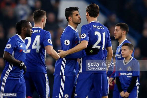 Chelsea's Brazilianborn Spanish striker Diego Costa bonds with teammates ahead of kick off in the English Premier League football match between...