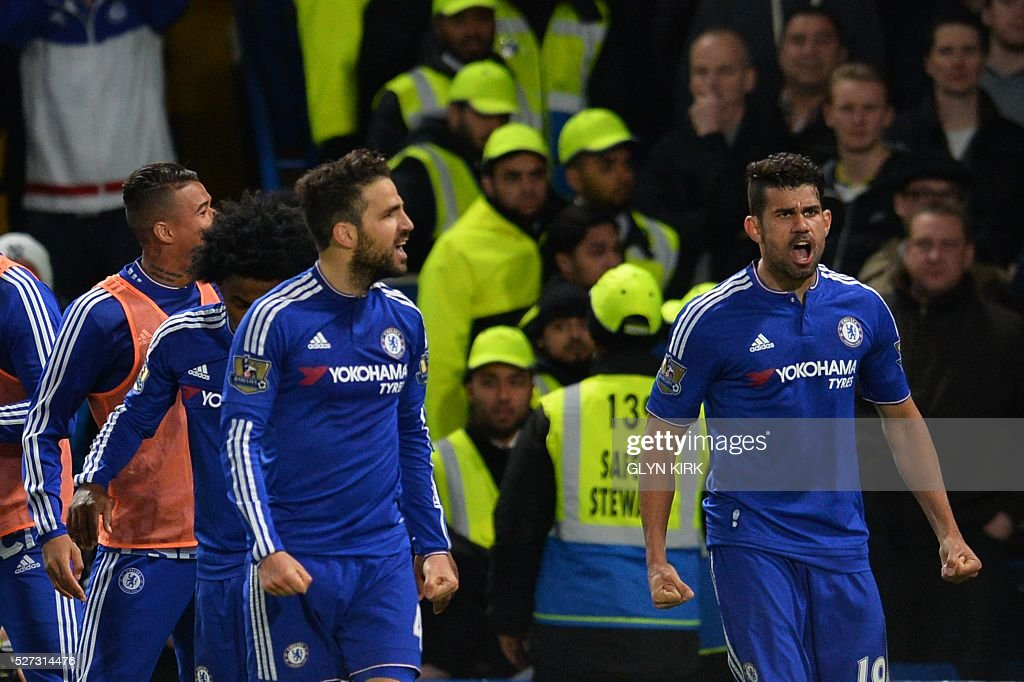 Chelsea's Brazilian-born Spanish striker Diego Costa (R) celebrates after Chelsea's Belgian midfielder Eden Hazard scored their second goal during the English Premier League football match between Chelsea and Tottenham Hotspur at Stamford Bridge in London on May 2, 2016. / AFP / GLYN KIRK / RESTRICTED TO EDITORIAL USE. No use with unauthorized audio, video, data, fixture lists, club/league logos or 'live' services. Online in-match use limited to 75 images, no video emulation. No use in betting, games or single club/league/player publications. /