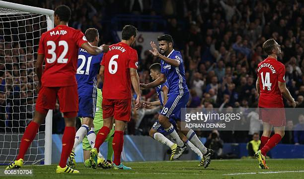 Chelsea's Brazilianborn Spanish striker Diego Costa celebrates score his team's first goal as Liverpool's Croatian defender Dejan Lovren and...