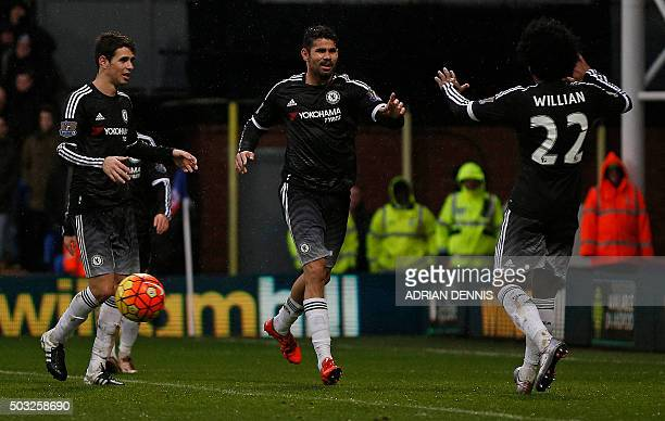 Chelsea's Brazilianborn Spanish striker Diego Costa celebrates scoring his team's third goal with Chelsea's Brazilian midfielder Oscar and Chelsea's...