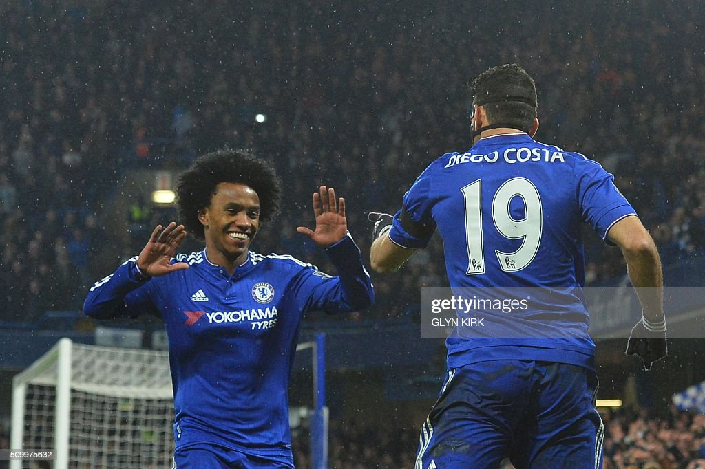 Chelsea's Brazilian-born Spanish striker Diego Costa (R) celebrates scoring his team's first goal with Chelsea's Brazilian midfielder Willian during the English Premier League football match between Chelsea and Newcastle United at Stamford Bridge in London on February 13, 2016. / AFP / GLYN KIRK / RESTRICTED TO EDITORIAL USE. No use with unauthorized audio, video, data, fixture lists, club/league logos or 'live' services. Online in-match use limited to 75 images, no video emulation. No use in betting, games or single club/league/player publications. /