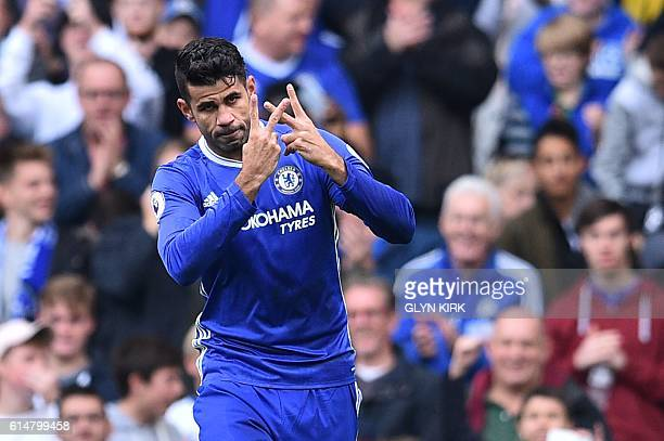 Chelsea's Brazilianborn Spanish striker Diego Costa celebrates with a gesture in support of Willian who's mother passed away recently after scoring...