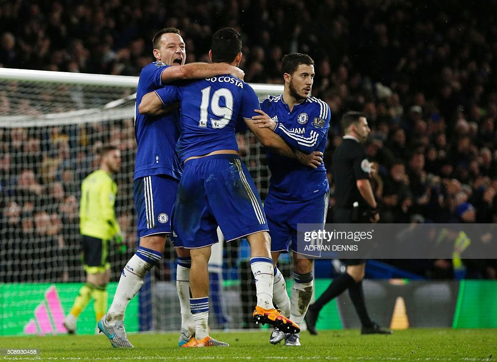 Chelsea's Brazilian-born Spanish striker Diego Costa (C) celebrates with Chelsea's English defender John Terry (L) and Chelsea's Belgian midfielder Eden Hazard after scoring during the English Premier League football match between Chelsea and Manchester United at Stamford Bridge in London on February 7, 2016. / AFP / ADRIAN DENNIS / RESTRICTED TO EDITORIAL USE. No use with unauthorized audio, video, data, fixture lists, club/league logos or 'live' services. Online in-match use limited to 75 images, no video emulation. No use in betting, games or single club/league/player publications. /