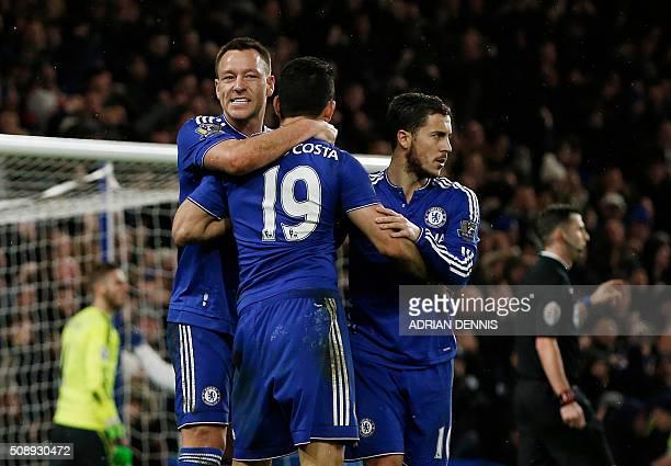 Chelsea's Brazilianborn Spanish striker Diego Costa celebrates with Chelsea's English defender John Terry and Chelsea's Belgian midfielder Eden...