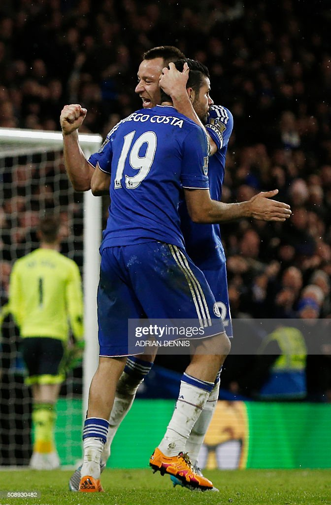 Chelsea's Brazilian-born Spanish striker Diego Costa (L) celebrates with Chelsea's English defender John Terry after scoring during the English Premier League football match between Chelsea and Manchester United at Stamford Bridge in London on February 7, 2016. / AFP / ADRIAN DENNIS / RESTRICTED TO EDITORIAL USE. No use with unauthorized audio, video, data, fixture lists, club/league logos or 'live' services. Online in-match use limited to 75 images, no video emulation. No use in betting, games or single club/league/player publications. /