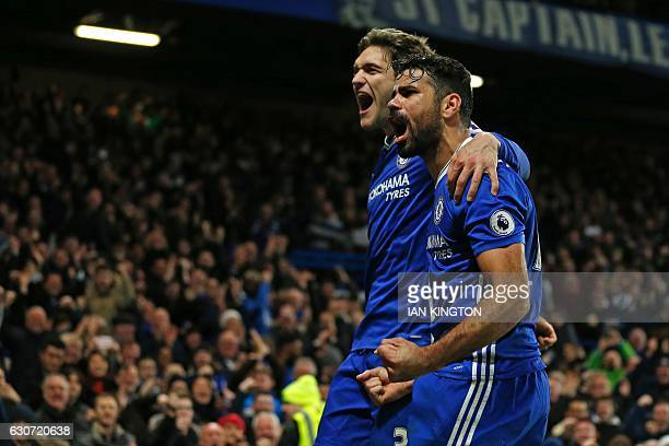 Chelsea's Brazilianborn Spanish striker Diego Costa celebrates with Chelsea's Spanish defender Marcos Alonso after scoring their fourth goal during...