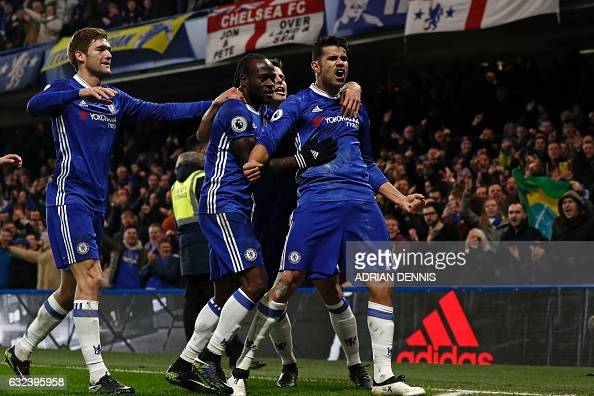 Chelsea's Brazilianborn Spanish striker Diego Costa celebrates with teammates after scoring the opening goal of the English Premier League football...