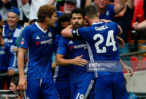 Chelsea's Brazilianborn Spanish striker Diego Costa celebrates with Chelsea's English defender Gary Cahill and Chelsea's Spanish defender Marcos...