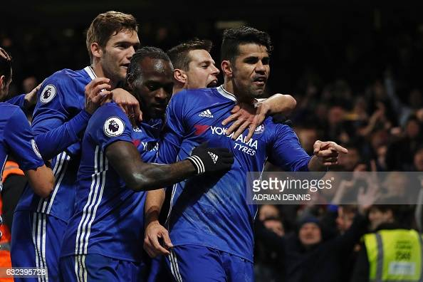 Chelsea's Brazilianborn Spanish striker Diego Costa gestures as he celebrates with teammates after scoring the opening goal of the English Premier...