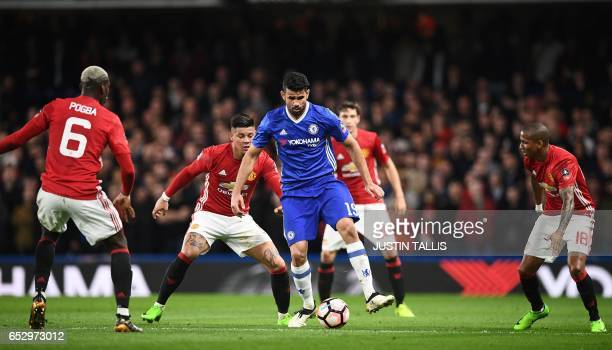 Chelsea's Brazilianborn Spanish striker Diego Costa is surrounded by Manchester United's French midfielder Paul Pogba Manchester United's Argentinian...