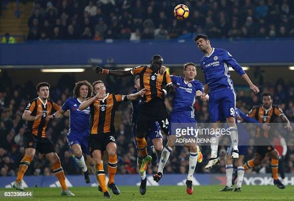 Chelsea's Brazilianborn Spanish striker Diego Costa jumps to head the ball clear during the English Premier League football match between Chelsea and...
