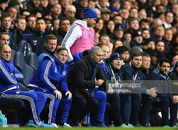 Chelsea's Brazilianborn Spanish striker Diego Costa passes Chelsea's Portuguese manager Jose Mourinho as he goes to warm up during the English...
