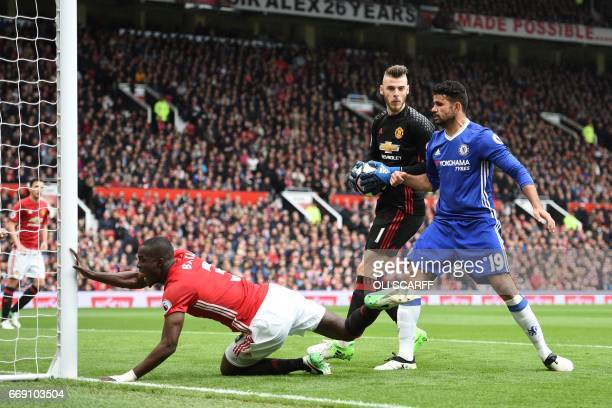 Chelsea's Brazilianborn Spanish striker Diego Costa pushes over Manchester United's Ivorian defender Eric Bailly as Manchester United's Spanish...
