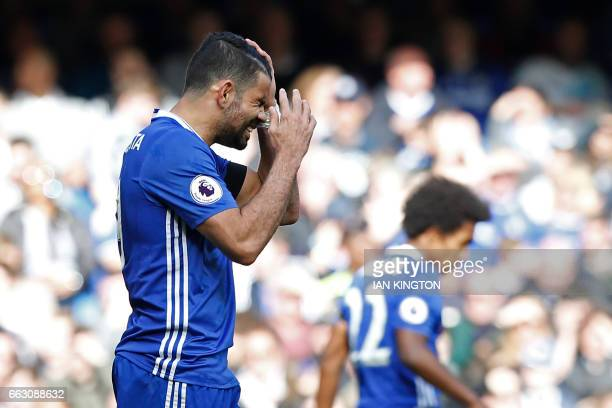 Chelsea's Brazilianborn Spanish striker Diego Costa reacts to missing a chance during the English Premier League football match between Chelsea and...