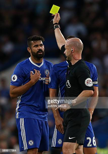 Chelsea's Brazilianborn Spanish striker Diego Costa receives a yellow card from referee Anthony Taylor during the English Premier League football...