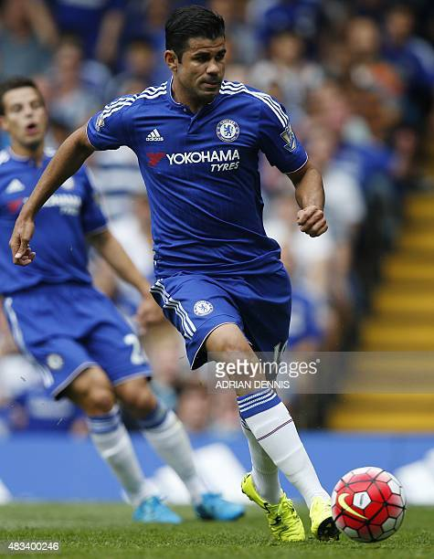 Chelsea's Brazilianborn Spanish striker Diego Costa runs with the ball during the English Premier League football match between Chelsea and Swansea...