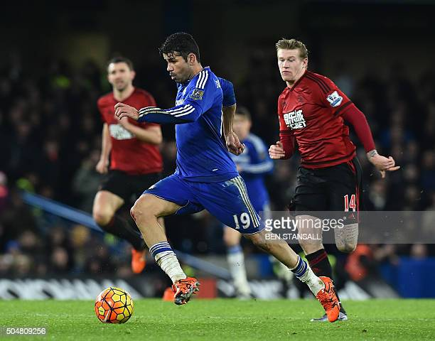 Chelsea's Brazilianborn Spanish striker Diego Costa runs with the ball during the English Premier League football match between Chelsea and West...