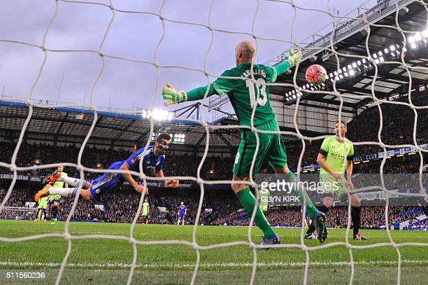 Chelsea's Brazilianborn Spanish striker Diego Costa scores a diving header past Manchester CIty's Argentinian goalkeeper Willy Caballero for the...