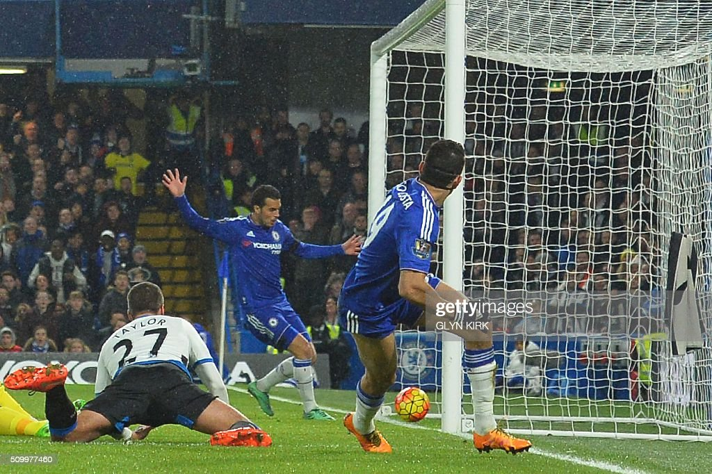 Chelsea's Brazilian-born Spanish striker Diego Costa (R) scores his team's first goal during the English Premier League football match between Chelsea and Newcastle United at Stamford Bridge in London on February 13, 2016. / AFP / GLYN KIRK / RESTRICTED TO EDITORIAL USE. No use with unauthorized audio, video, data, fixture lists, club/league logos or 'live' services. Online in-match use limited to 75 images, no video emulation. No use in betting, games or single club/league/player publications. /