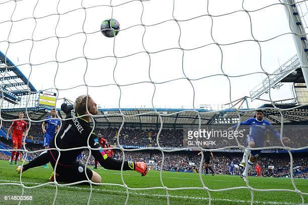 Chelsea's Brazilianborn Spanish striker Diego Costa scores the opening goal past Leicester City's Danish goalkeeper Kasper Schmeichel during the...