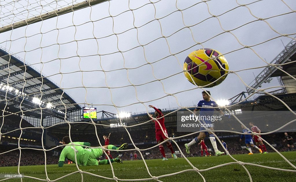 Chelsea's Brazilianborn Spanish striker Diego Costa sees the ball hit the back of the net as he opens the scoring in the English Premier League...
