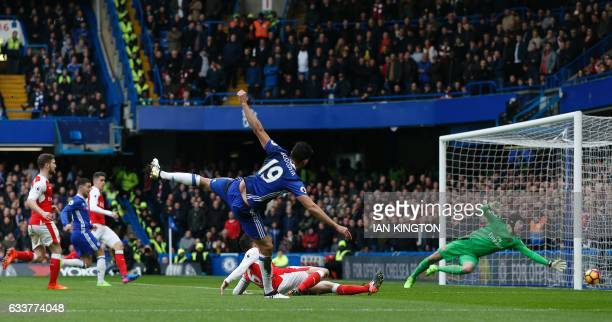 TOPSHOT Chelsea's Brazilianborn Spanish striker Diego Costa sends a shot wide during the English Premier League football match between Chelsea and...