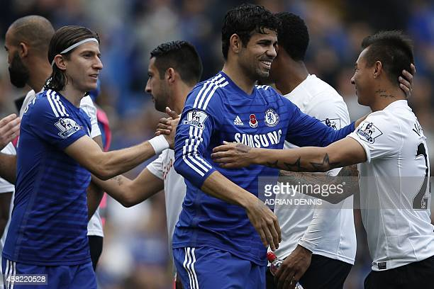 Chelsea's Brazilianborn Spanish striker Diego Costa shakes hands with Queens Park Rangers' Chilean striker Eduardo Vargas during the English Premier...
