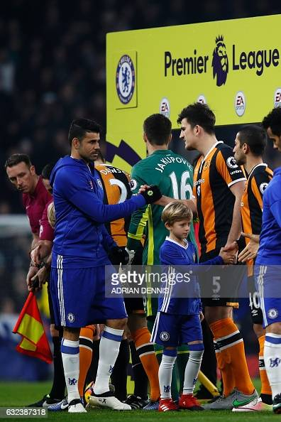 Chelsea's Brazilianborn Spanish striker Diego Costa shakes hands with Hull City's English defender Harry Maguire ahead of kick off in the English...