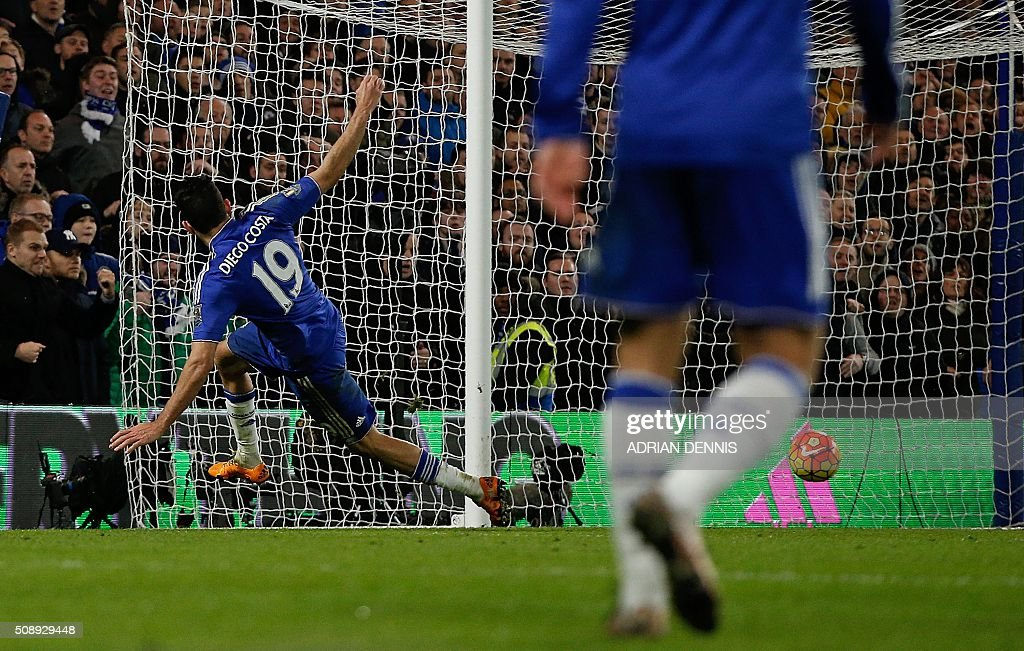 Chelsea's Brazilian-born Spanish striker Diego Costa shoots and scores during the English Premier League football match between Chelsea and Manchester United at Stamford Bridge in London on February 7, 2016. / AFP / ADRIAN DENNIS / RESTRICTED TO EDITORIAL USE. No use with unauthorized audio, video, data, fixture lists, club/league logos or 'live' services. Online in-match use limited to 75 images, no video emulation. No use in betting, games or single club/league/player publications. /