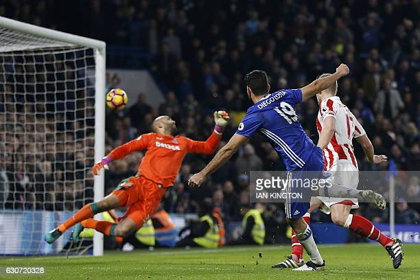 Chelsea's Brazilianborn Spanish striker Diego Costa shoots past Stoke City's English goalkeeper Lee Grant to score their fourth goal during the...