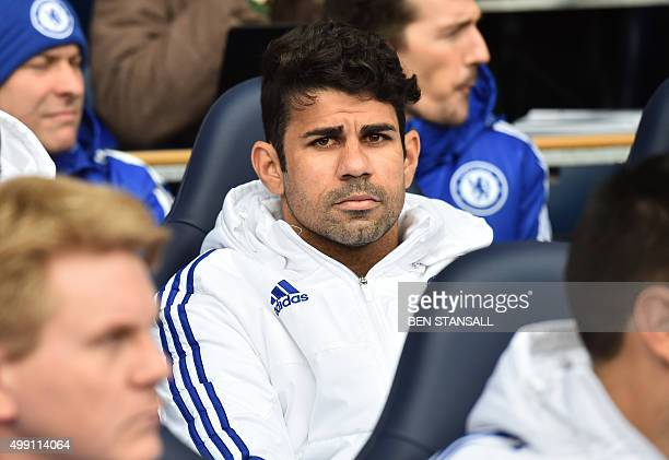 Chelsea's Brazilianborn Spanish striker Diego Costa sits on the bench before the English Premier League football match between Tottenham Hotspur and...