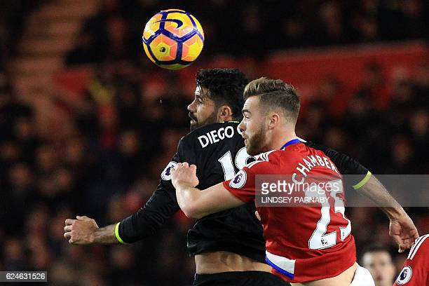 Chelsea's Brazilianborn Spanish striker Diego Costa vies in the air with Middlesbrough's English defender Calum Chambers during the English Premier...