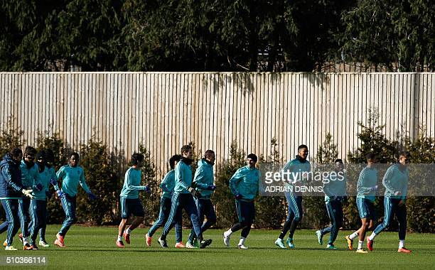 Chelsea's Brazilianborn Spanish striker Diego Costa warms up with teammates during a training session at the club's complex in Cobham Surrey on...