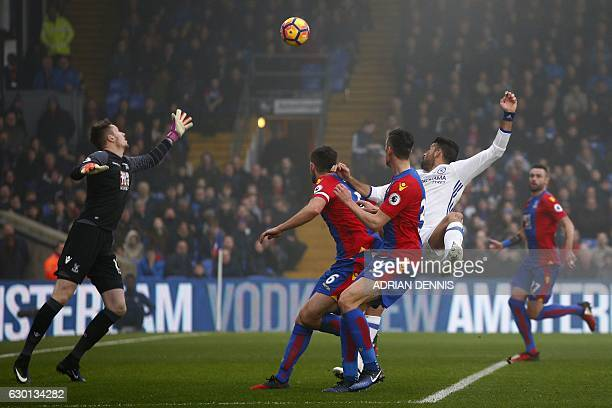 Chelsea's Brazilianborn Spanish striker Diego Costa watches the ball after jumping to head and score his team's first goal during the English Premier...