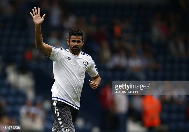 Chelsea's Brazilianborn Spanish striker Diego Costa waves as he warms up ahead of the English Premier League football match between West Bromwich...