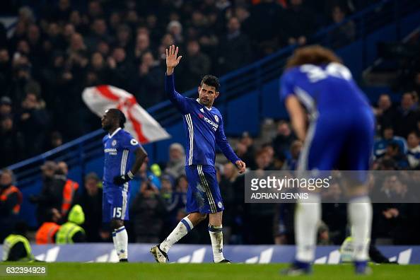 Chelsea's Brazilianborn Spanish striker Diego Costa waves to supporters as he is substituted during the English Premier League football match between...