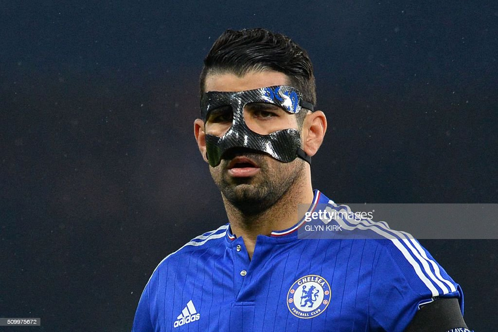 Chelsea's Brazilian-born Spanish striker Diego Costa wears a protective face mask during the English Premier League football match between Chelsea and Newcastle United at Stamford Bridge in London on February 13, 2016. / AFP / GLYN KIRK / RESTRICTED TO EDITORIAL USE. No use with unauthorized audio, video, data, fixture lists, club/league logos or 'live' services. Online in-match use limited to 75 images, no video emulation. No use in betting, games or single club/league/player publications. /
