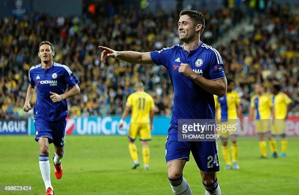 Chelsea's British defender Gary Cahill celebrates after scoring a goal during their UEFA champions league match between Maccabi Tel Aviv and Chelsea...