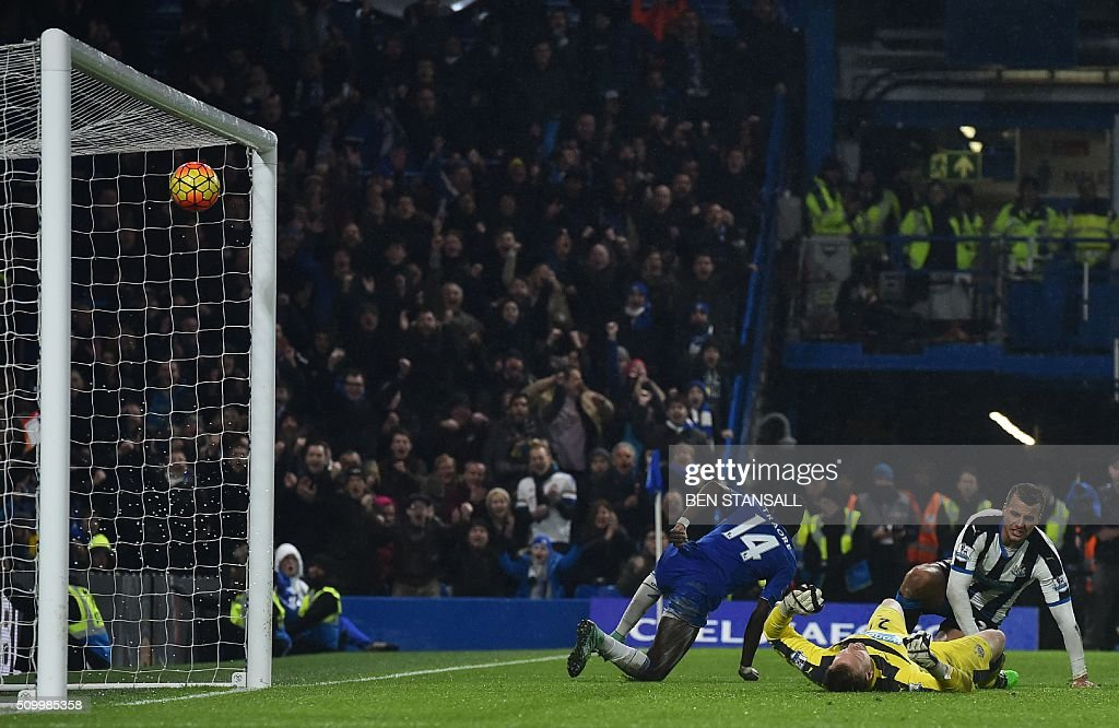 Chelsea's Burkina Faso midfielder Bertrand Traore (L) scores their fifth goal during the English Premier League football match between Chelsea and Newcastle United at Stamford Bridge in London on February 13, 2016. / AFP / BEN STANSALL / RESTRICTED TO EDITORIAL USE. No use with unauthorized audio, video, data, fixture lists, club/league logos or 'live' services. Online in-match use limited to 75 images, no video emulation. No use in betting, games or single club/league/player publications. /