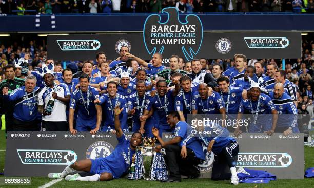 Chelsea's captain John Terry and his players celebrate with the trophy after winning the league with an 80 victory during the Barclays Premier League...