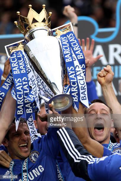 Chelsea's captain John Terry and Juliano Belletti celebrate with the trophy after winning the league with an 80 victory during the Barclays Premier...