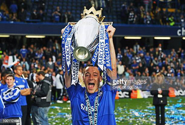 Chelsea's captain John Terry celebrates with the Barclays Premier league trophy after they win the title with a 80 victory over Wigan Athletic in the...