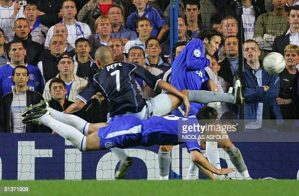 Chelsea's captain John Terry hits a diving header to score past Porto's Pepe during their Champions League football match 29 September 2004 at...
