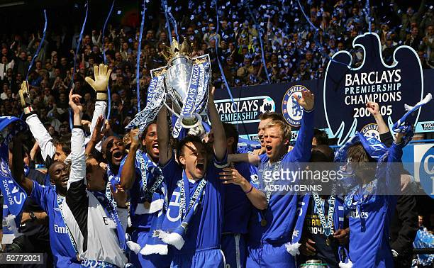 Chelsea's Captain John Terry lifts the Barclays Premiership trophy alongside the rest of the team during the celebration after the game against...