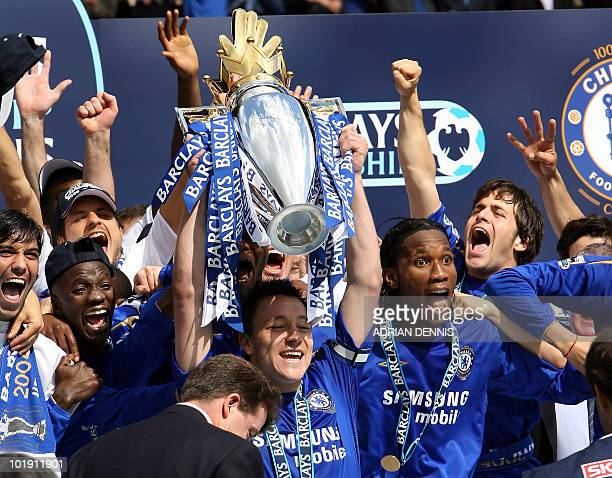 Chelsea's Captain John Terry lifts the Premiership trophy alongside Didier Drogba and Joe Cole after defeating Manchester United to win the...