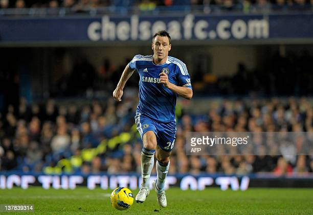 Chelsea's captain John Terry runs with the ball during the English Premier League football match between Chelsea and Aston Villa at Stamford Bridge...