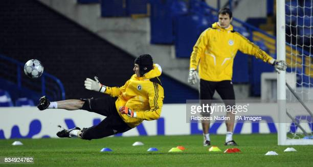 Chelsea's Carlo Cudicini watches Petr Cech during a training session at Stamford Bridge London