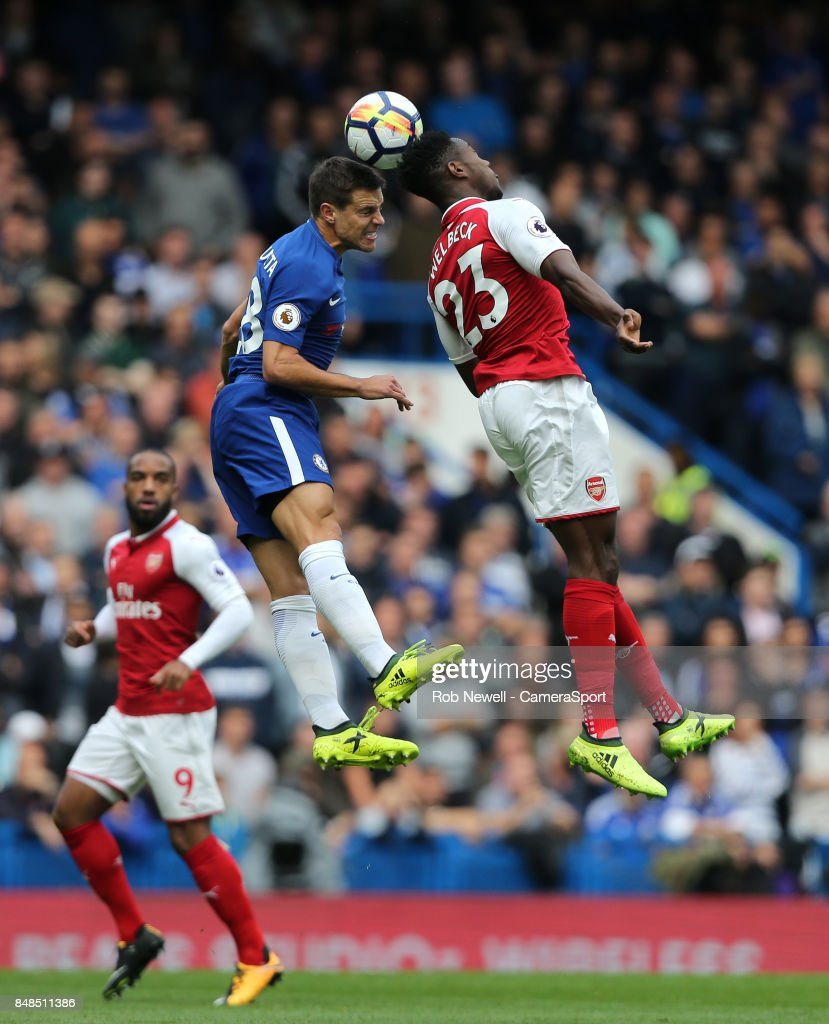 Chelsea's Cesar Azpilicueta and Arsenal's Danny Welbeck during the Premier League match between Chelsea and Arsenal at Stamford Bridge on September 17, 2017 in London, England.